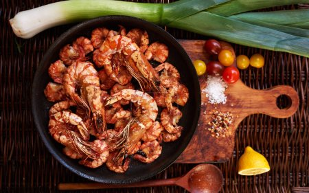Housewife fried appetizer, Royal shrimp, tiger prawns, crabs, all laid out on a bright contrast dish served with lemon wedges, cherry tomatoes and parey can be cut and just put on a plate