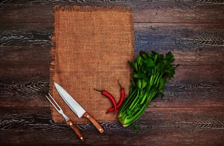 Ideas for the restaurant, dishes in a rustic style on linen with vintage silver knife and fork, betrays a great bunch of greens fresh flavor to any dish