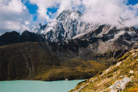 Mountain range with beautiful clouds. Mountain landscape. View on the lake Gokyo Ri. Blue sky with clouds. Himalaya mountains of Nepal, snow covered high peaks and lake not far from Everest.