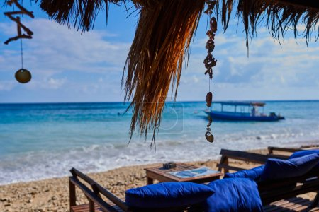 Photo for Wooden sunbed for relaxing on the paradise beach. Tropical recreational for vacation. Summer morning ocean view. Tropical sea resort beach serene scene. Relaxing atmosphere. Travel concept. - Royalty Free Image