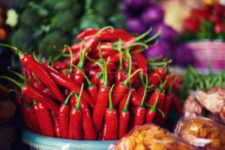Bright summer background. Red chili in farmer market. Healthy vegetarian vegetables, organic food, raw ingredient. Natural nutrition for diet. Organic vegetables. Summer crops. Selective focus.