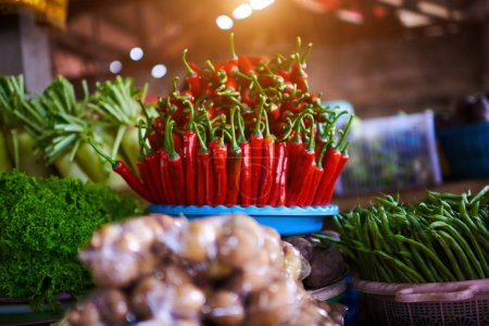 Colorful fruits and vegetables in the marketplace. Bright summer background. Healthy vegetables, food, raw ingredient. Natural nutrition for diet. Organic vegetables. Summer crops. Selective focus.