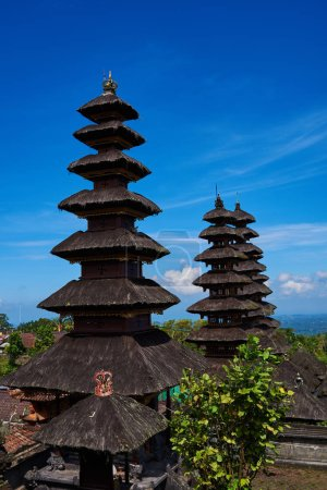 Pura Besakih, Balinese hindu temple ornamented by beautiful carvings and sculptures. Famous picturesque landmark located in the central part of Bali, near Agung volcano. Summer and vacation concept.