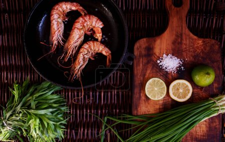 Three fresh tiger prawns fried on home barbecue to beer to wine to men and women