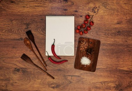 In the kitchen, the restaurant is a notebook student chefs left him lying next to a cutting board tomatoes of which will be prepared sauce
