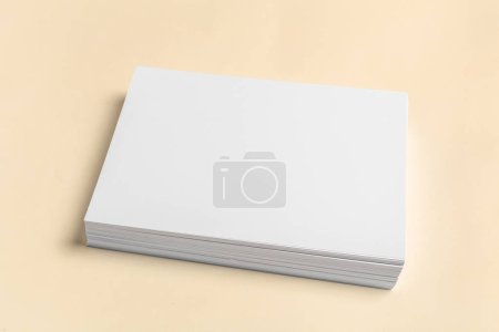 Stack of white business cards on wooden table