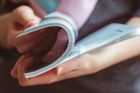 Close view of woman reading magazine