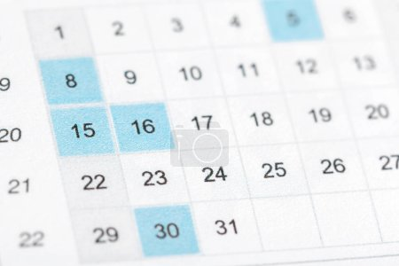 Close up of dates on calendar page