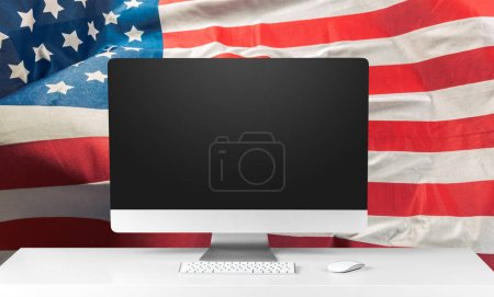 US flag and laptop on background