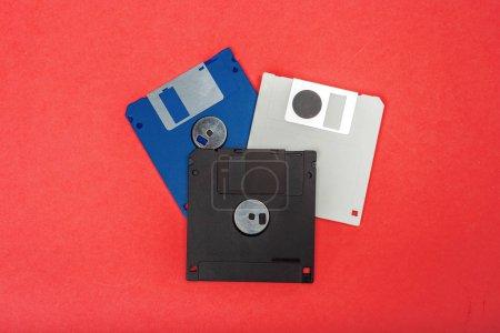 Computer floppy disks on color background