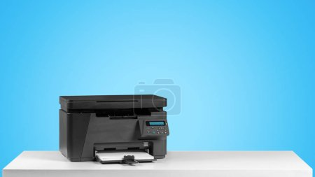 Printer copier machine on bright blue background