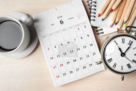 work space with calendar pages on wooden background
