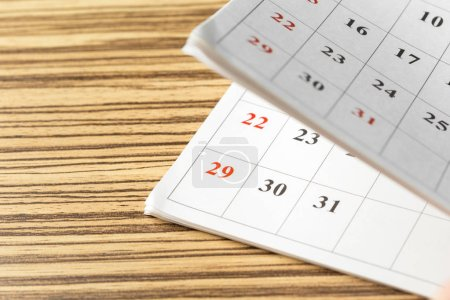 calendar pages on wooden table