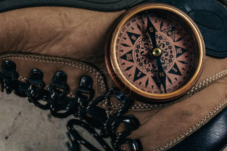 compass with hiking-boots, close up view