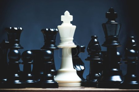 Chess pieces set on chessboard, close-up