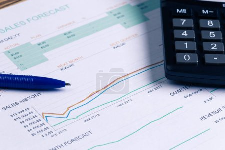 Photo for Business charts and graphs with Calculator, close-up - Royalty Free Image