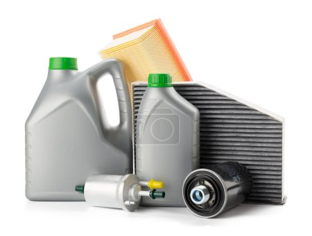 Car oil filters and motor oil cans isolated on white background, close-up