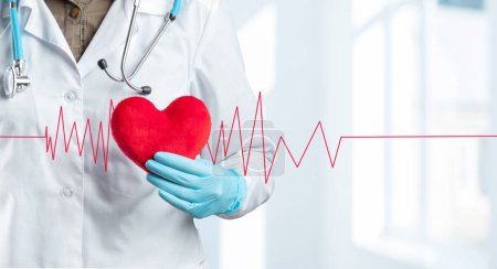 Cropped photo of doctor or medical professional  with red heart