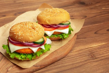 Fast food, homemade burgers on a wooden background