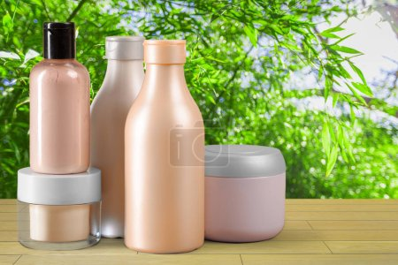 Different cosmetic products on wooden table