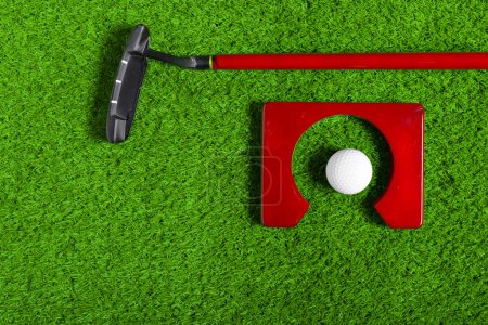 Golf ball and Golf Club on Grass, close-up view