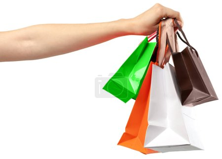 Shopping Bag. Female hand holding shopping bag on white