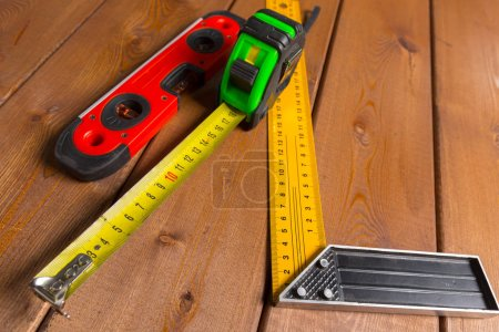 Tape measure on wooden background. top view.