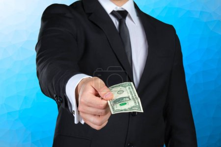 Unrecognizable businessman shows dollar banknote
