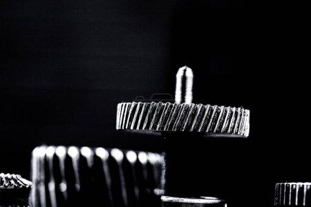 Metal gears on black background