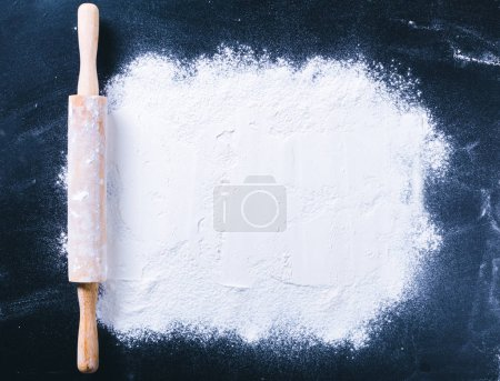 Baking desk with flour and rolling pin, top view