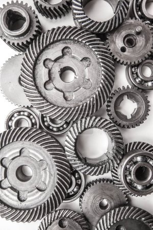 close-up view of gear metal wheels, isolated on white background