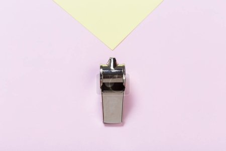 Referee Whistle on color background
