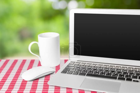 Photo for Laptop with blank screen on table - Royalty Free Image
