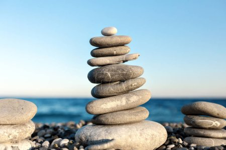 Seashore background with stone construction concept of balance and harmony