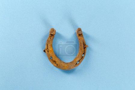 Old rusty horseshoe on background