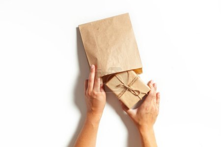 Woman's hands wrapping a gift