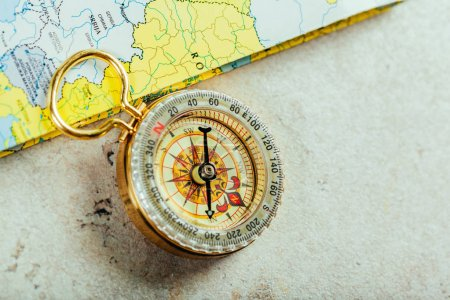 Compass, map on background,close up