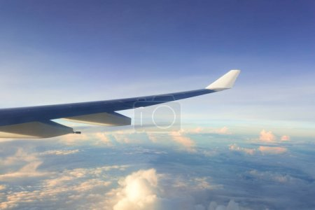 airplane in the sky, vacation and travel concept