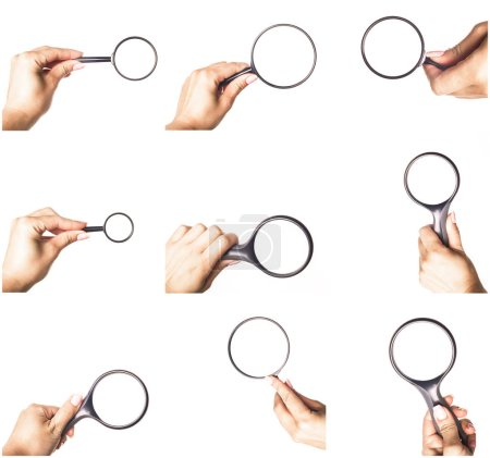 Hand with magnifying glass isolated on white