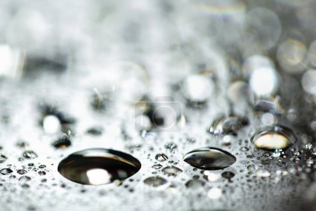 water drops splashes on black floor