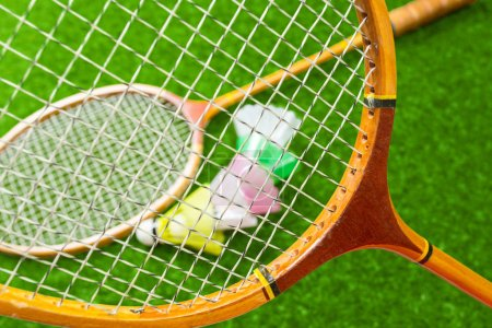 Badminton on grass, close up view