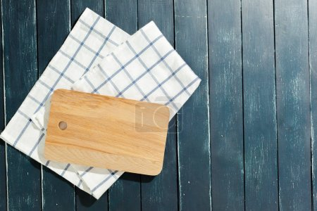 Photo for Empty wooden board with tablecloth on dark desk - Royalty Free Image
