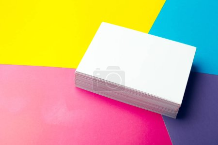 Blank business cards on colorful abstract backgrou...