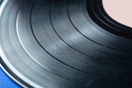 Retro vinyl record on blue background