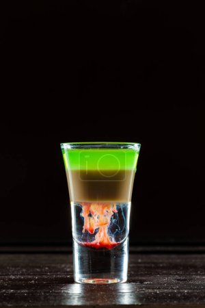 Colorful alcoholic cocktail in a shot glass