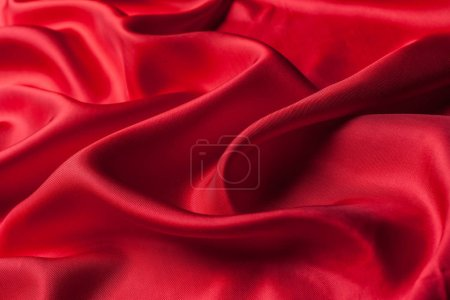 bright red cloth waves texture, close-up