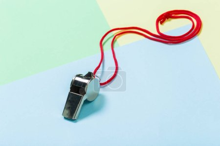 Close up of referee Whistle with red rope