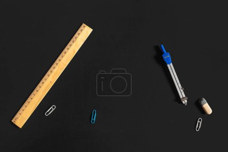 Stationary on dark background, close-up, education concept