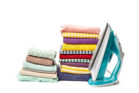 Electric iron and pile of clothes