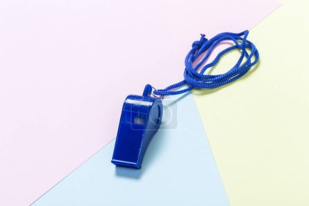 Referee Whistle on light colorful background